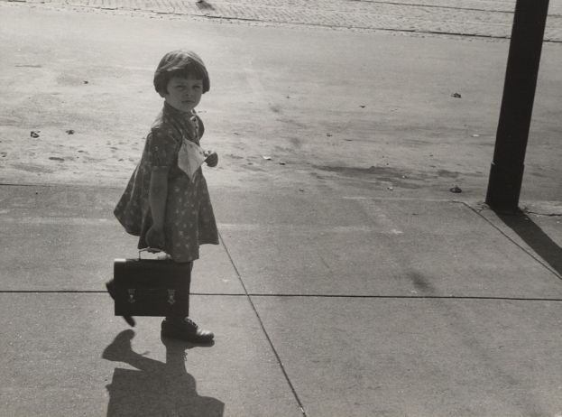 girl carrying lunch pail
