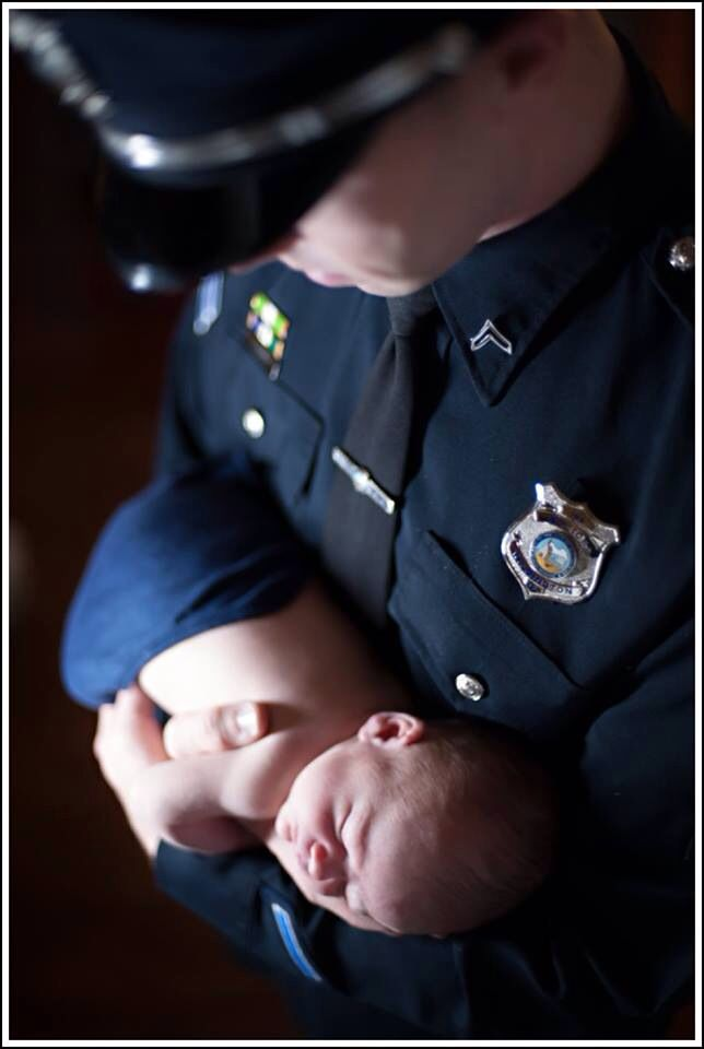 cop holding baby 2